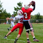 Trevor Gerig wins the battle for a pass in the JV game.