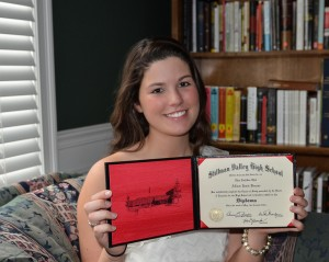Allison shows her 2012 Stillman Valley Diploma