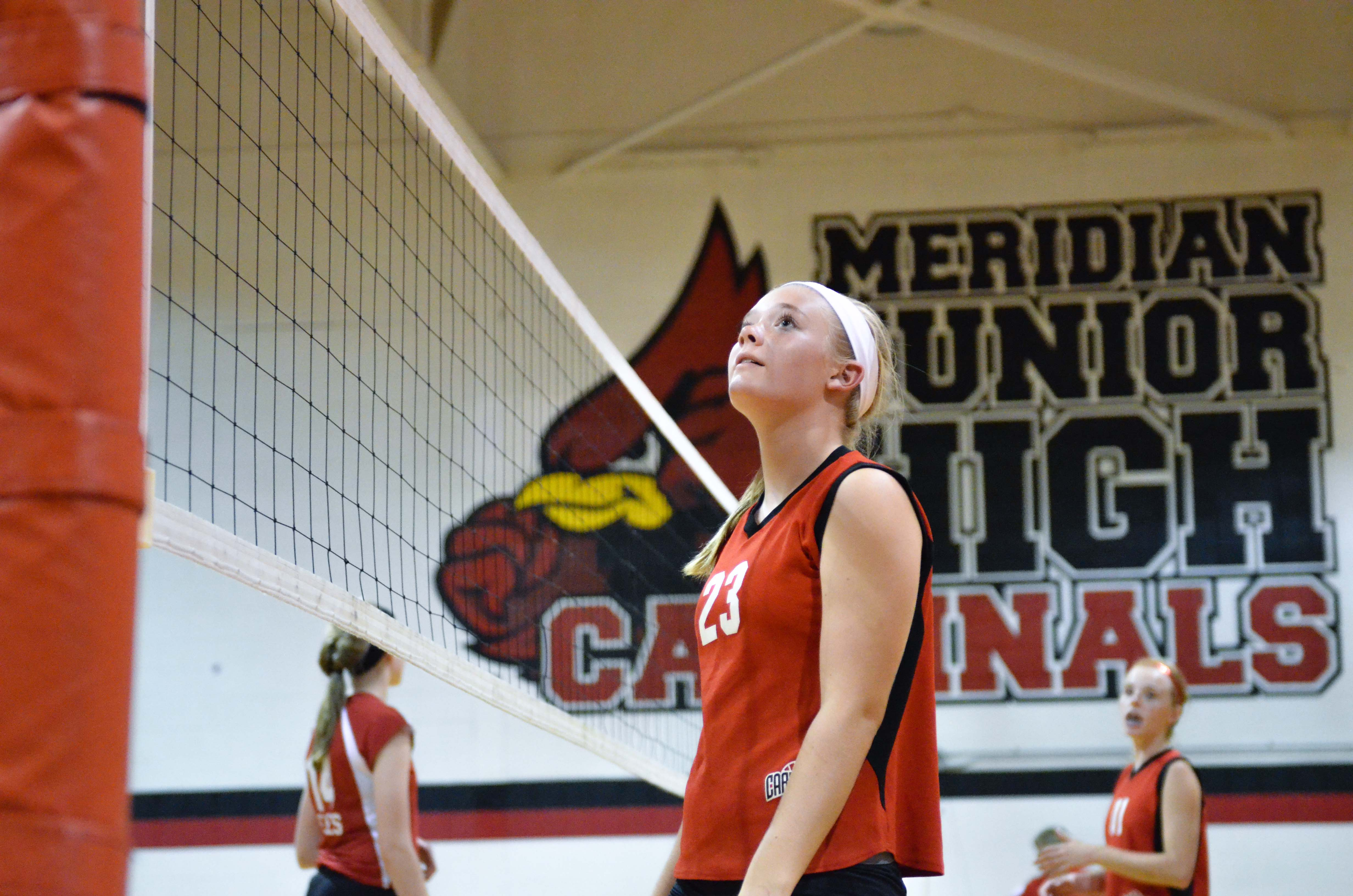 A 7th Grader looks for the right call in volleyball